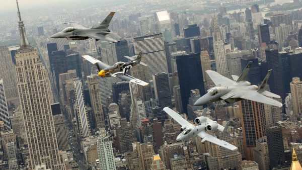 NEW YORK -- A P-51 Mustang, flown by Jim Beasley; an F-16 Fighting Falcon, flown by Maj. Dax Cornelius from Hill Air Force Base, Utah; an F-15 Eagle, flown by Capt. Tony Bierenkoven from Eglin AFB, Fla.; and an A-10 Thunderbolt II, flown by Capt. Jeff Yost of Pope AFB, N.C., fly over New York City on Thursday, May 25, 2006. The