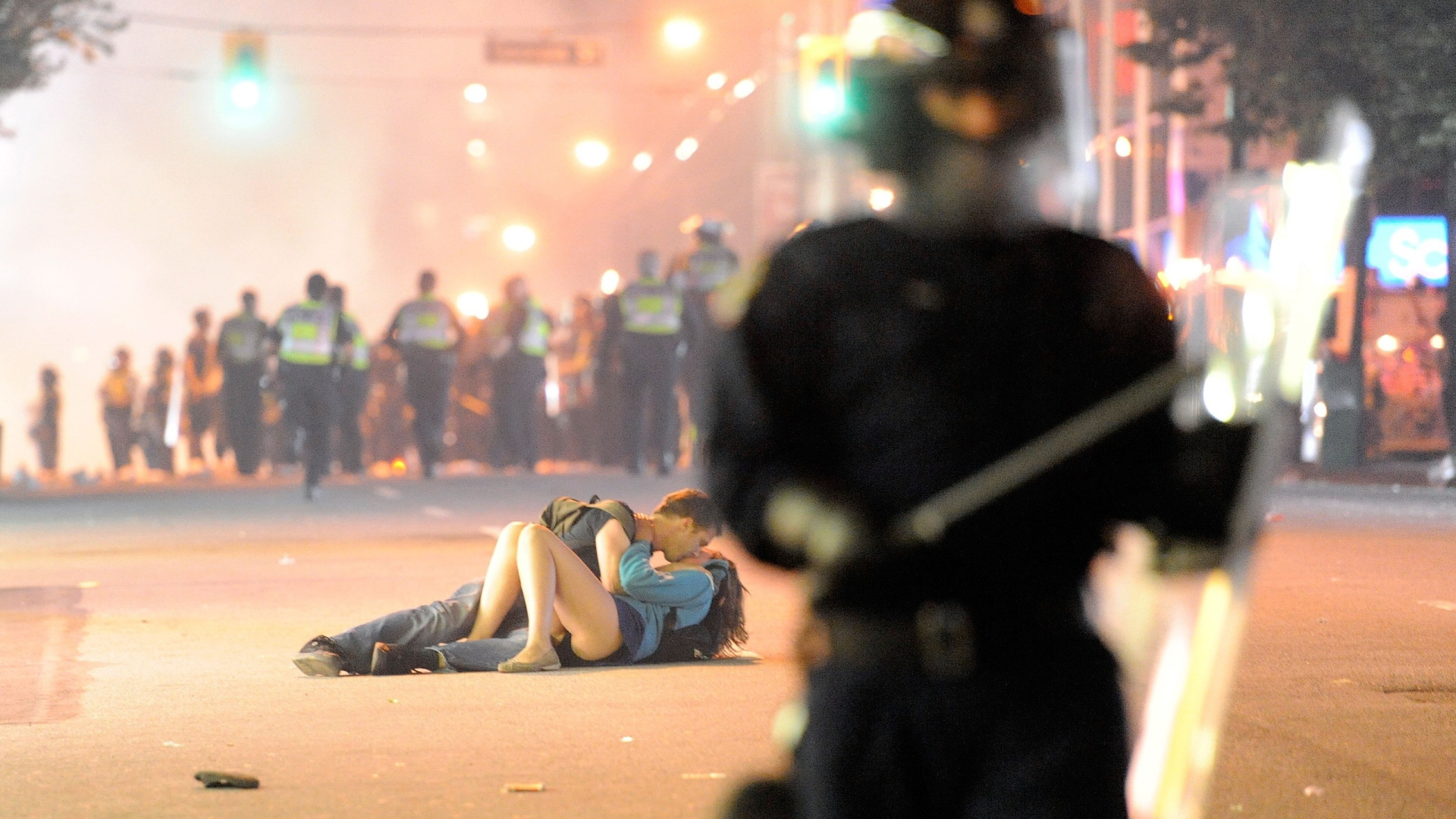 A-couple-are-seen-in-the-middle-of-the-Vancouver-riot-after-the-Canucks-lost-to-the-Boston-Bruins-in-wallpaper-wp3602077