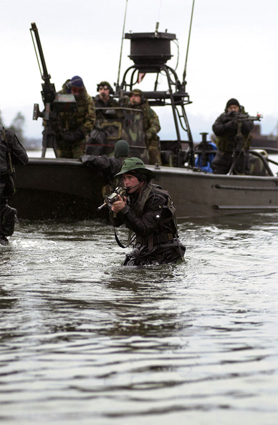 A-member-of-SEAL-Team-covers-his-team-mates-as-they-are-extracted-by-members-of-Navy-Special-Boat-wallpaper-wp4603410