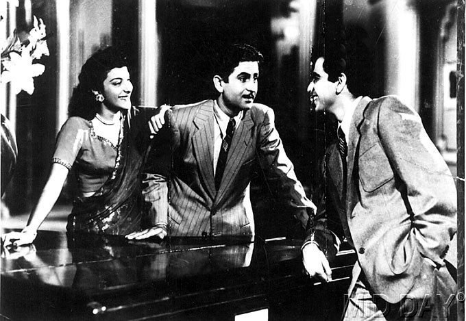 A-still-from-the-film-Andaz-starring-Nargis-Dilip-Kumar-and-Raj-Kapoor-wallpaper-wp5004221
