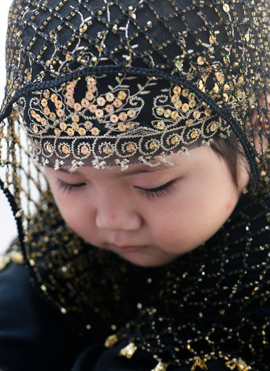 A-young-Chinese-Muslim-girl-attends-prayers-for-Eid-Al-Fitr-at-the-Niujie-Mosque-in-Beijing-China-wallpaper-wp3002948