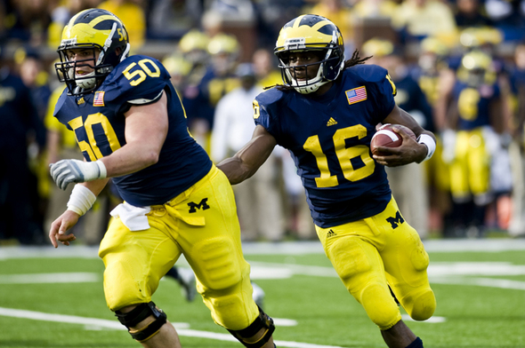 At-foot-former-Michigan-center-David-Molk-is-one-inch-taller-than-quarterback-Denard-Robin-wallpaper-wp5803690