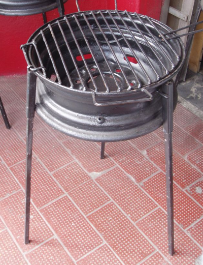 Barbeque-made-from-a-tire-rim-The-legs-come-off-and-the-lid-flips-Easy-to-put-in-the-back-of-your-wallpaper-wp4804514
