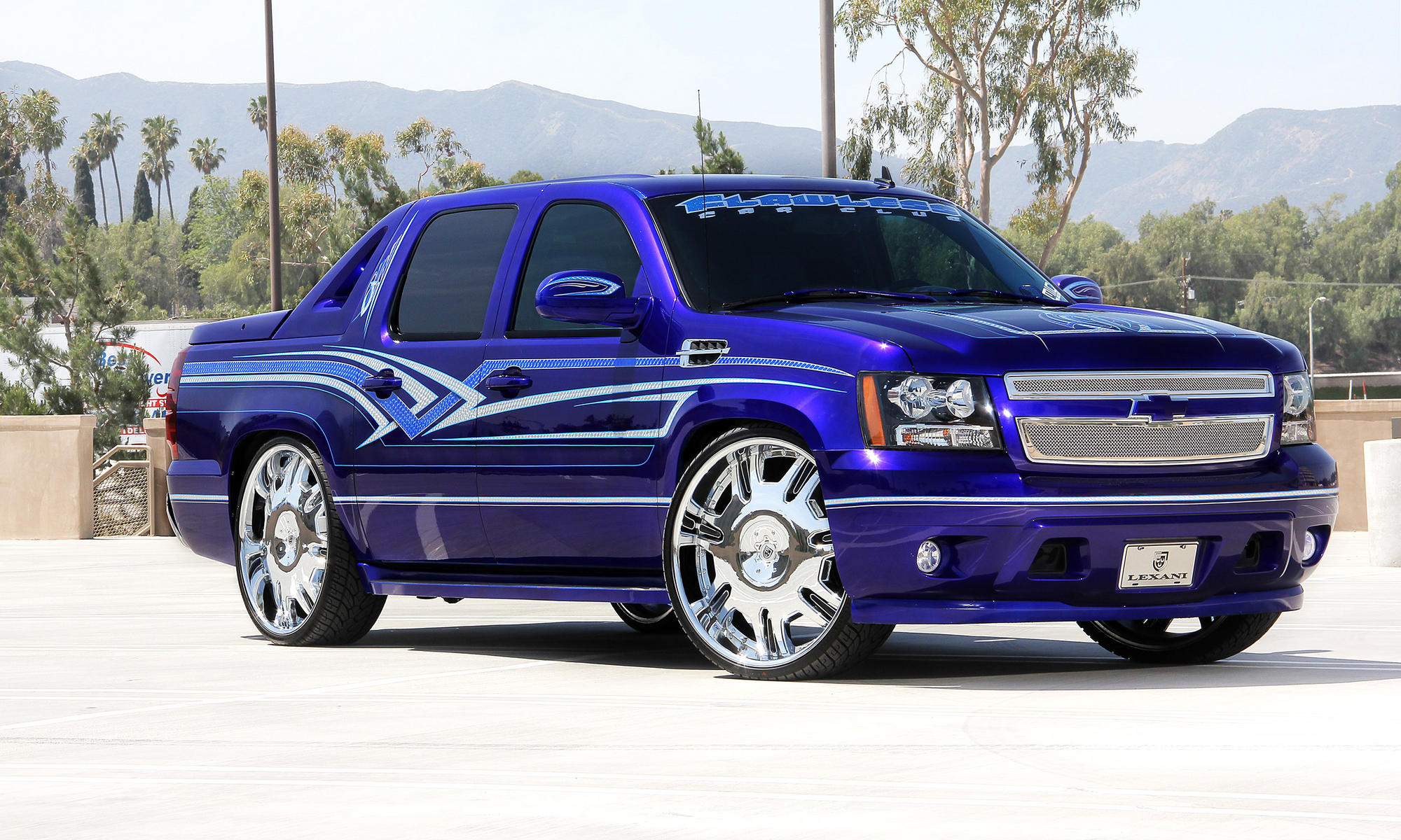 Blue-custom-Chevy-Avalanche-with-chrome-radiant-wheels-wallpaper-wp4604315-1