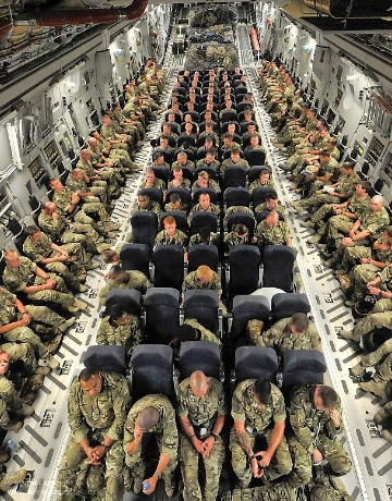 British-troops-onboard-an-RAF-C-transport-aircraft-enroute-to-Camp-Bastion-in-Afghanistan-wallpaper-wp5804215