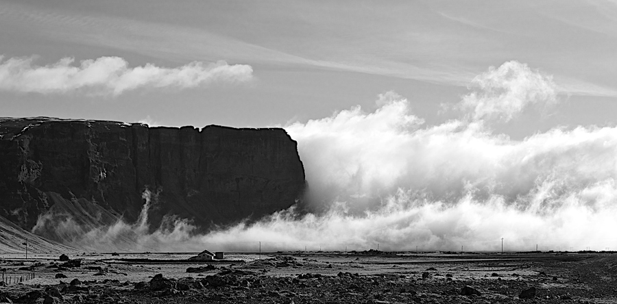 Clouds-breaking-at-the-cliffs-of-L%C3%B3magn%C3%BApur-Iceland-wallpaper-wp5006145