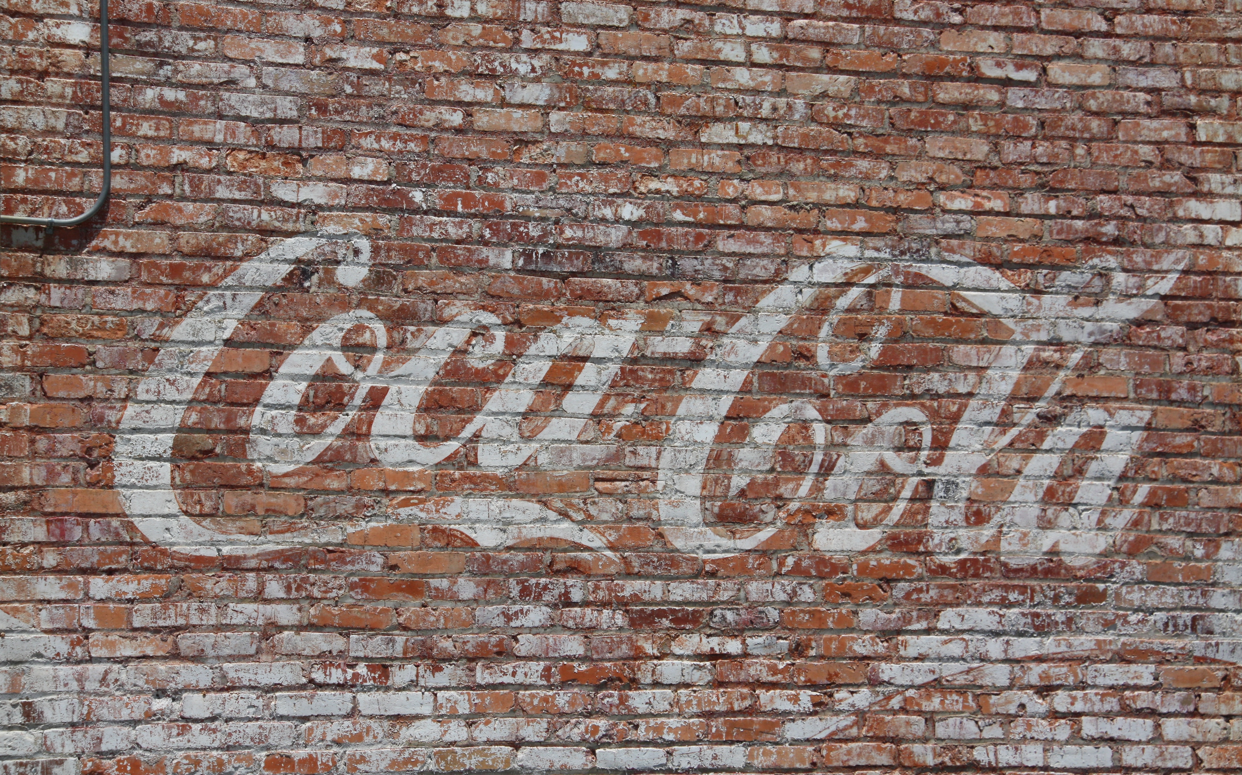 Coca-Cola-wall-NC-Love-this-faded-Coca-Cola-logo-painted-on-this-old-brick-wall-wallpaper-wp5603952