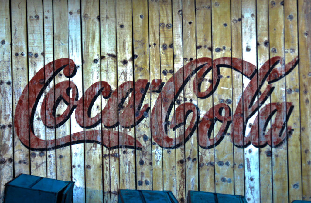 Coca-cola-wall-Quilombo-SC-Brasil-The-logo-is-painted-in-muted-red-onto-a-knotty-p-wallpaper-wp5603959