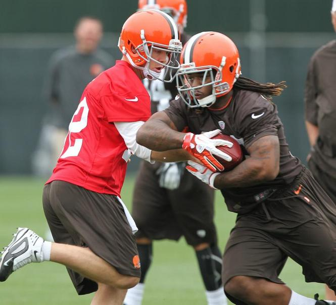Colt-McCoy-hands-off-to-Trent-Richardson-on-Tuesday-morning-during-OTAs-in-Berea-wallpaper-wp4805470