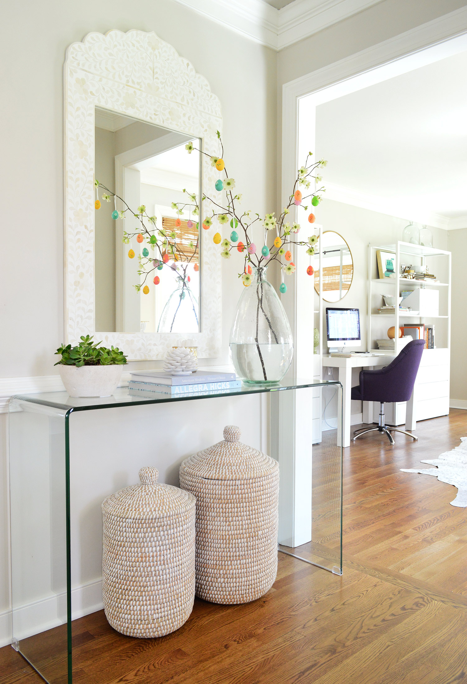 Easter-Egg-tree-in-foyer-with-acrylic-console-table-and-inlay-mirror-with-decorative-baskets-underne-wallpaper-wp4004475-1