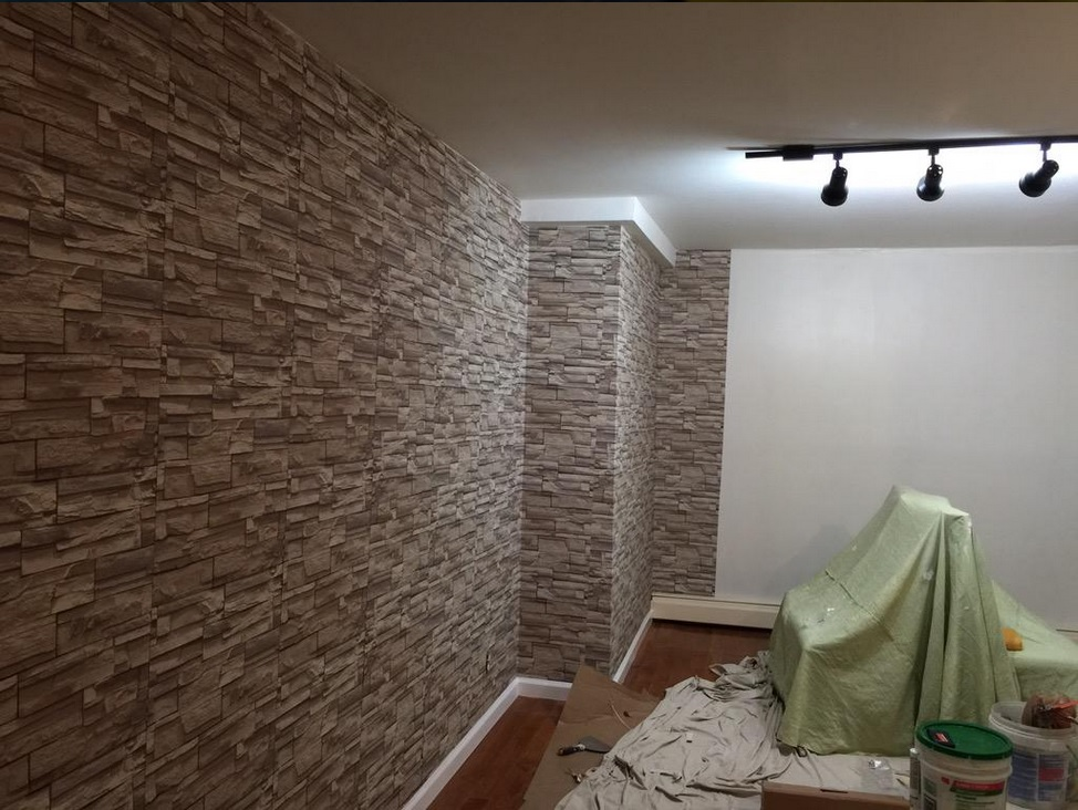 Faux-stone-being-installed-in-home-by-This-pattern-is-called-wallpaper-wp5805589