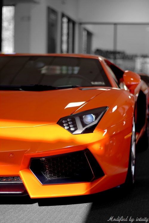 If-you-buy-an-expensive-sports-car-surely-orange-is-the-only-way-to-go-wallpaper-wp5605808