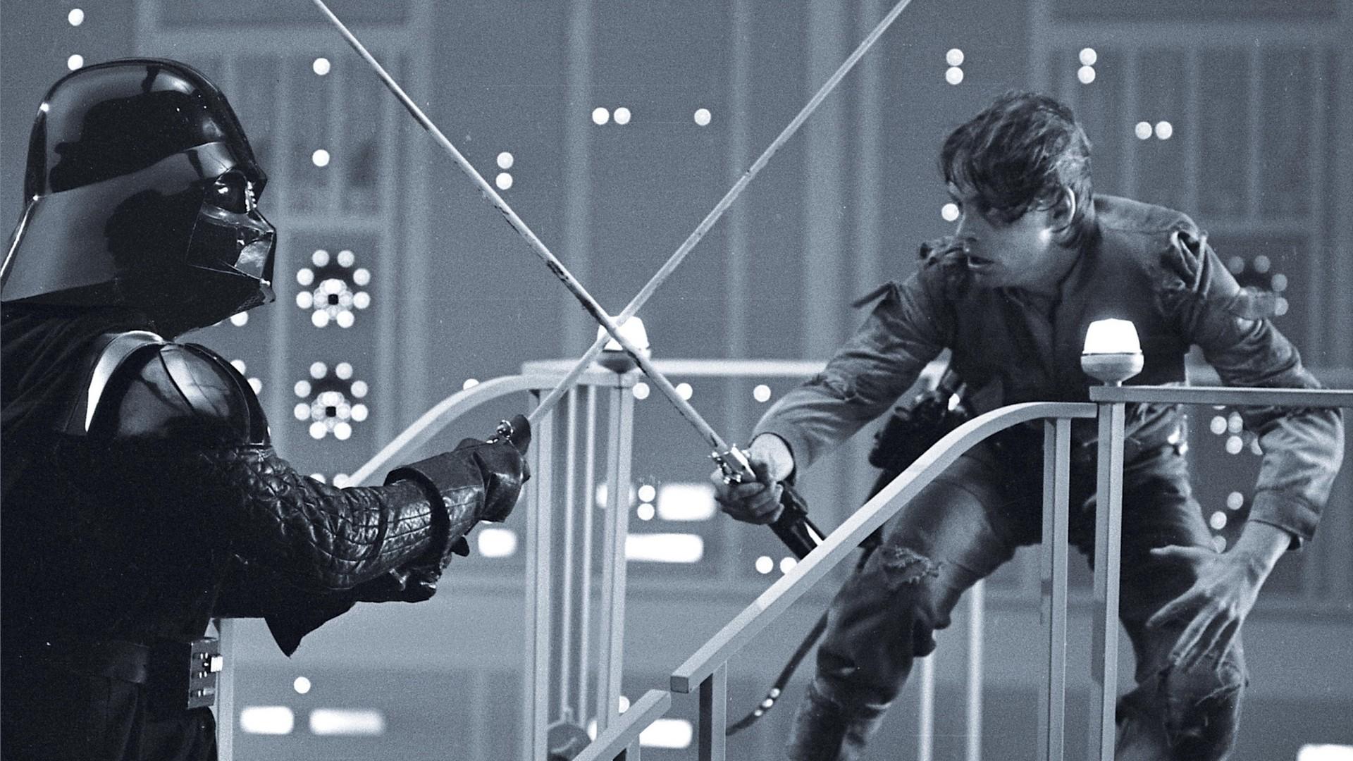 Luke-skywalker-vs-darth-vader-black-and-white-lightsaber-battle-wallpaper-wp3408324