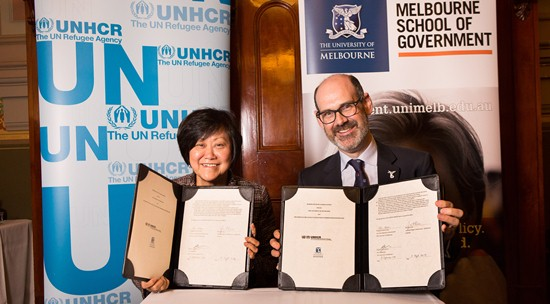 Ms-Janet-Lim-UNHCR-and-Professor-Simon-Evans-Pro-Vice-Chancellor-International-at-the-signing-wallpaper-wp3408857
