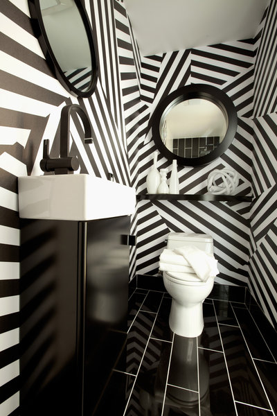 Pop-Art-from-Black-Crow-Studios-was-a-great-idea-to-jazz-up-this-tiny-powder-room-Christi-wallpaper-wp4609289