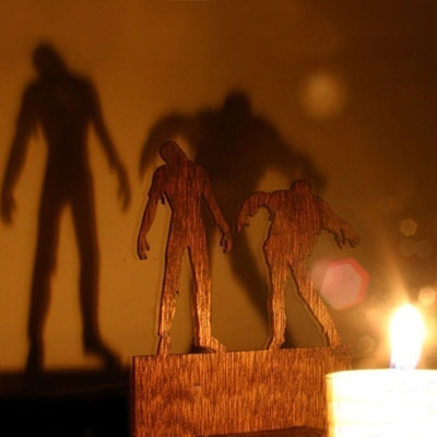 a-mahogany-plywood-Halloween-decoration-used-to-cast-a-shadow-that-looks-like-menacing-zombies-wallpaper-wp5803214