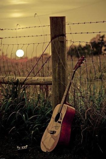 guitar-against-fence-post-wallpaper-wp5405448