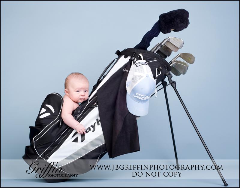 newborn-baby-in-golf-bag-wallpaper-wp427931