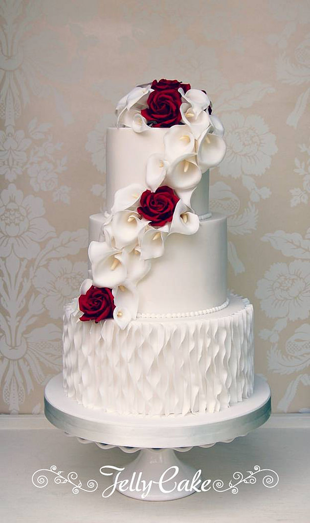 A-pretty-cascade-of-sugar-calla-lilies-and-deep-red-roses-to-match-the-wedding-flowers-cascading-d-wallpaper-wpc5801883