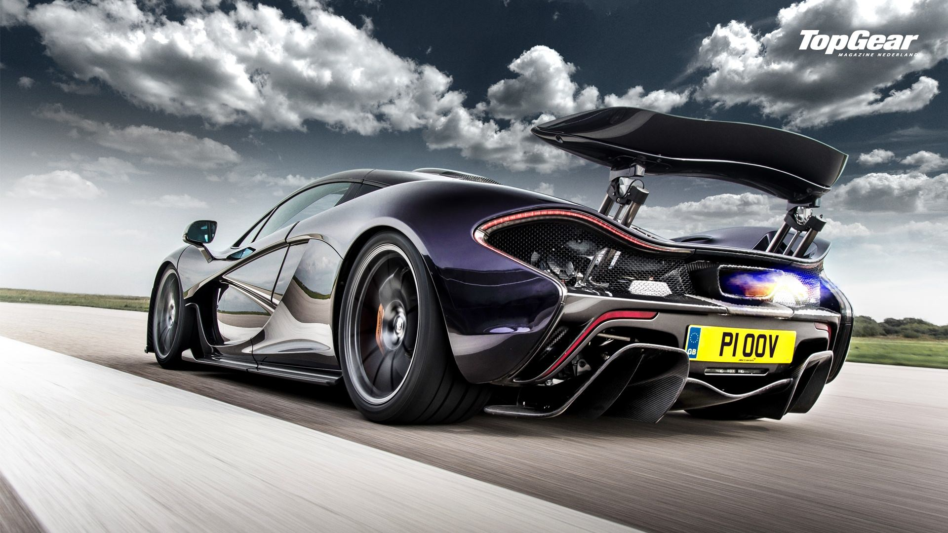 Awesome-purple-McLaren-P-rear-side-view-shooting-flames-on-the-track-image-via-top-wallpaper-wpc9002472