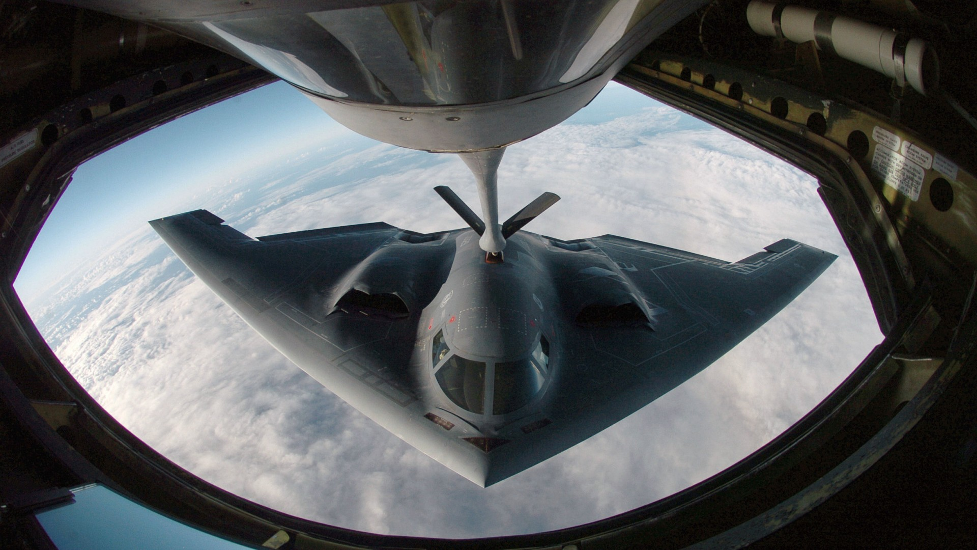 B-stealth-bomber-getting-fuelled-in-air-wallpaper-wpc9002491