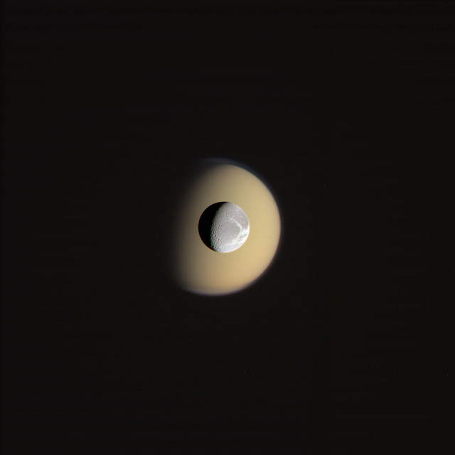 Dione-in-front-of-Titan-of-Saturn-s-moons-wallpaper-wp3804572