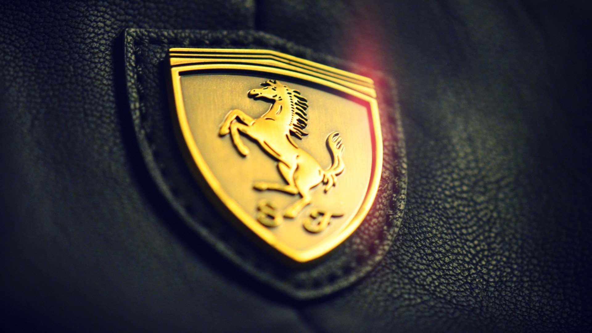 Ferrari-logo-wallpapesr-hd-1080p-black-and-gold-wallpaper-wp3805259