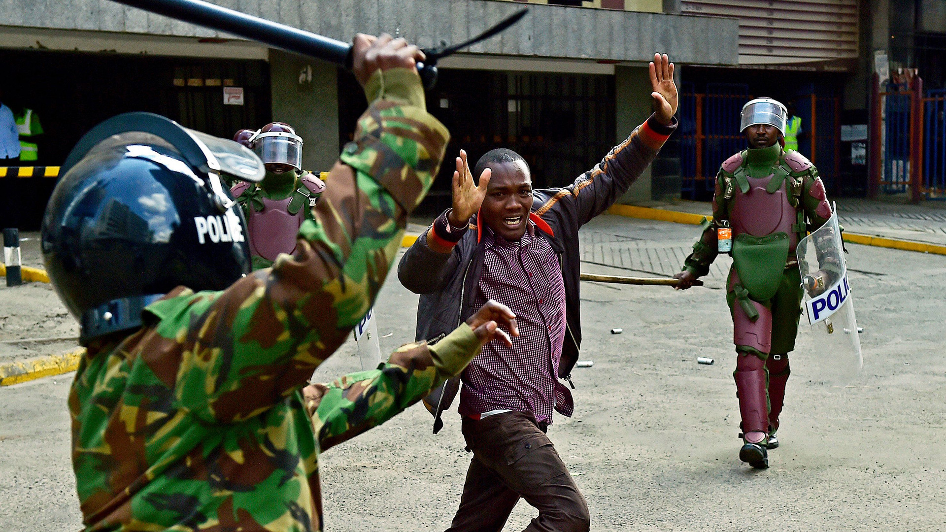 Kenyan-riot-police-officers-raise-batons-over-a-man-during-a-demonstration-of-Kenyas-opposition-sup-wallpaper-wpc9006875