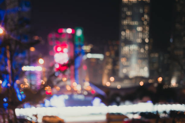 blur-image-of-hong-kong-city-with-circle-bokeh-wallpaper-wpc5802942