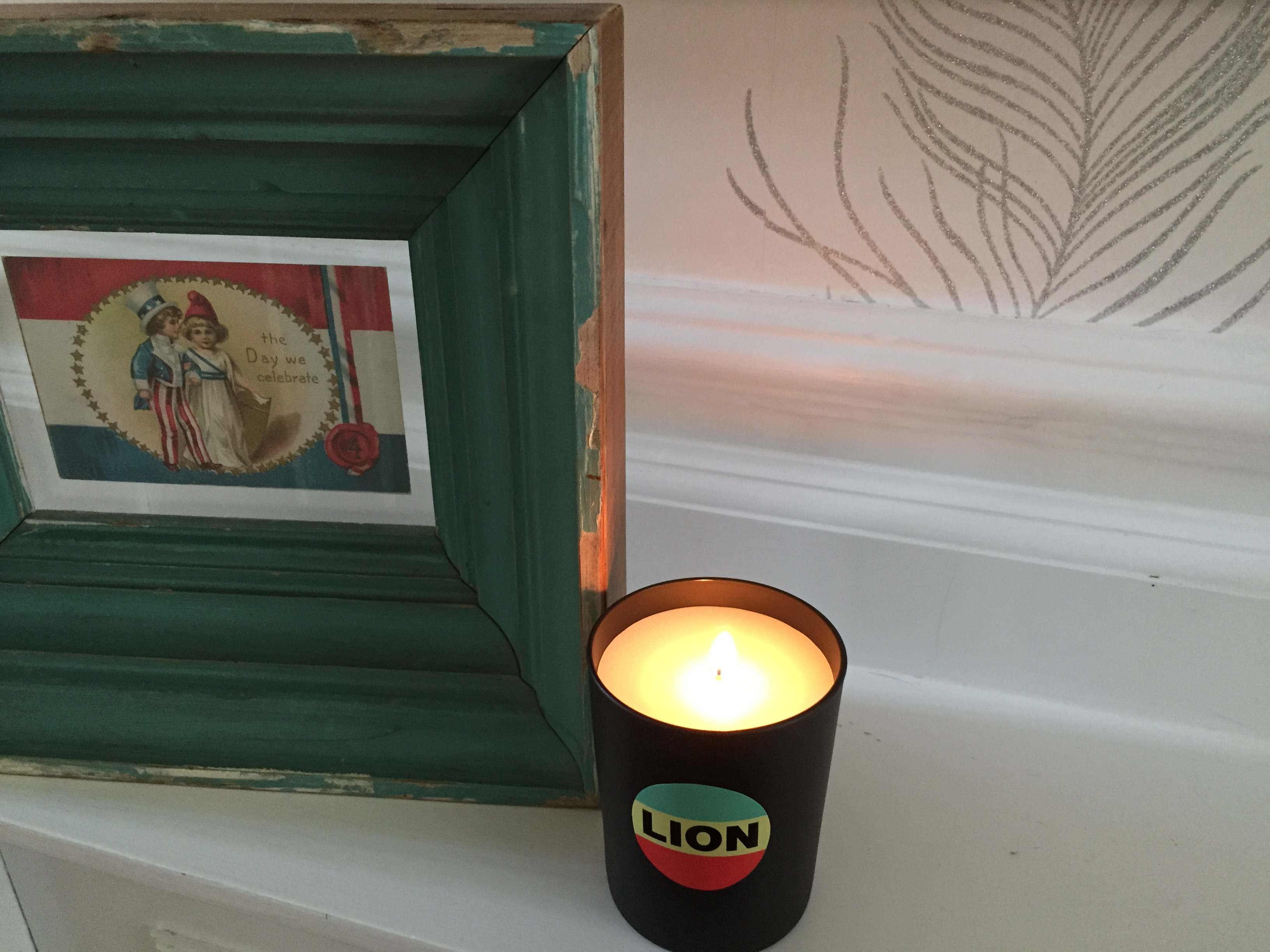 A-Bella-Freud-candle-and-vintage-frame-with-silver-lined-wall-paper-in-our-hallway-wallpaper-wp5803192