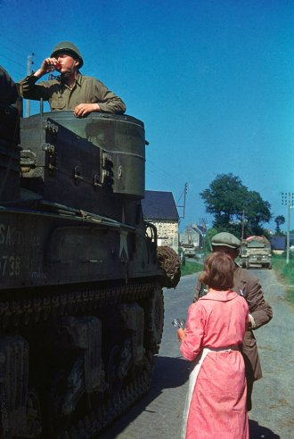 A-French-couple-shares-cognac-with-an-American-tank-crew-after-Allied-forces-liberated-the-area-wallpaper-wp3002875