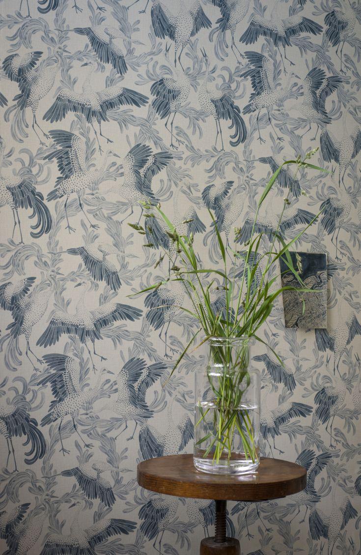 A-beautiful-design-featuring-graceful-cranes-in-flight-wallpaper-wp5004167