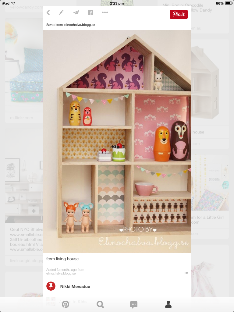 A-cute-dolls-house-with-wallpaper-on-its-walls-wallpaper-wp4803825