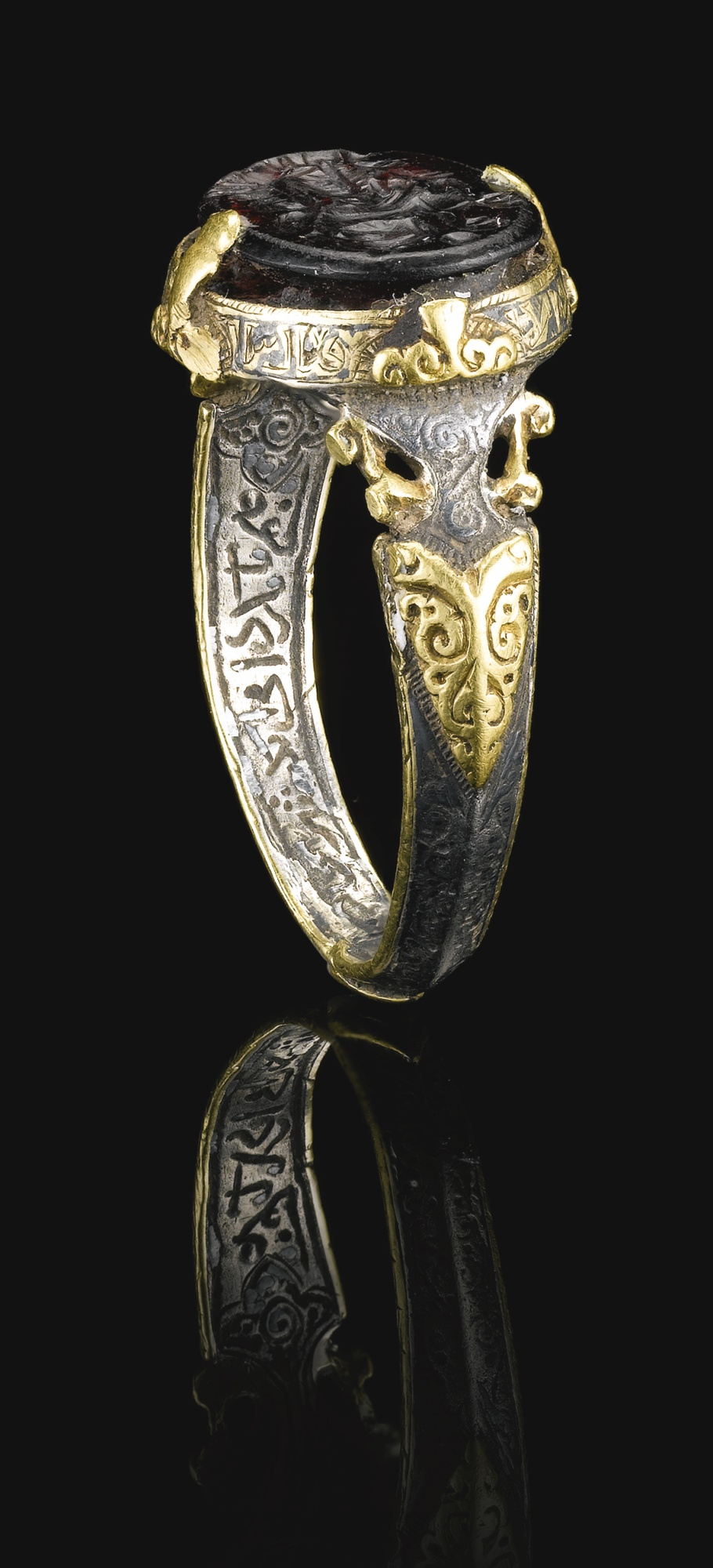 A-fine-and-rare-Seljuk-silver-and-gold-ring-set-with-a-deep-purple-stone-seal-bearing-the-name-of-Al-wallpaper-wp5004183