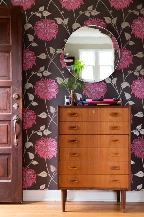 A-vintage-dresser-stands-out-against-a-gorgeous-floral-wallpaper-wp4603455