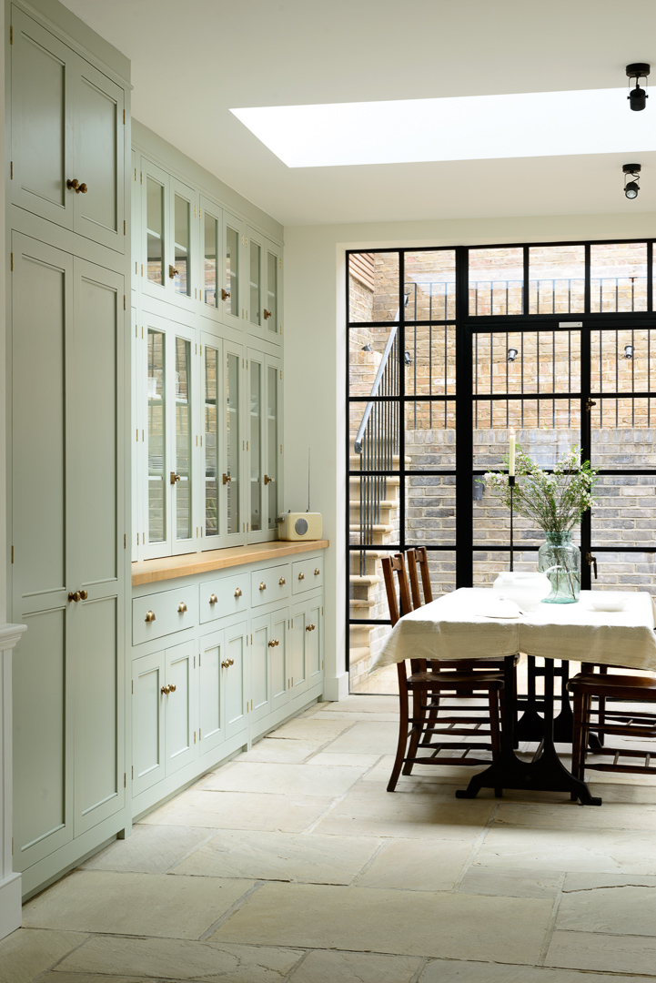 A-whole-wall-of-beautiful-cupboards-from-deVOLs-Classic-English-kitchen-range-and-tall-crittall-wi-wallpaper-wp4603456