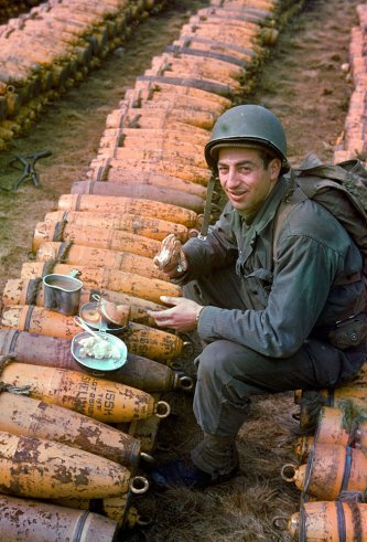 American-combat-engineers-eat-a-meal-atop-boxes-of-ammunition-stockpiled-for-the-impending-D-Day-inv-wallpaper-wp3003153