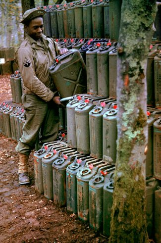 An-American-corporal-stacks-cans-of-gasoline-in-preparation-for-the-upcoming-invasion-of-France-Str-wallpaper-wp3003194
