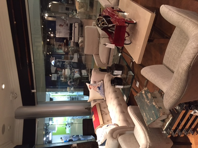 Andrew-Martins-Athos-Sofa-Surrounding-are-our-Porthos-Chair-Log-Side-Table-Soho-Coffee-Table-and-wallpaper-wp5602899
