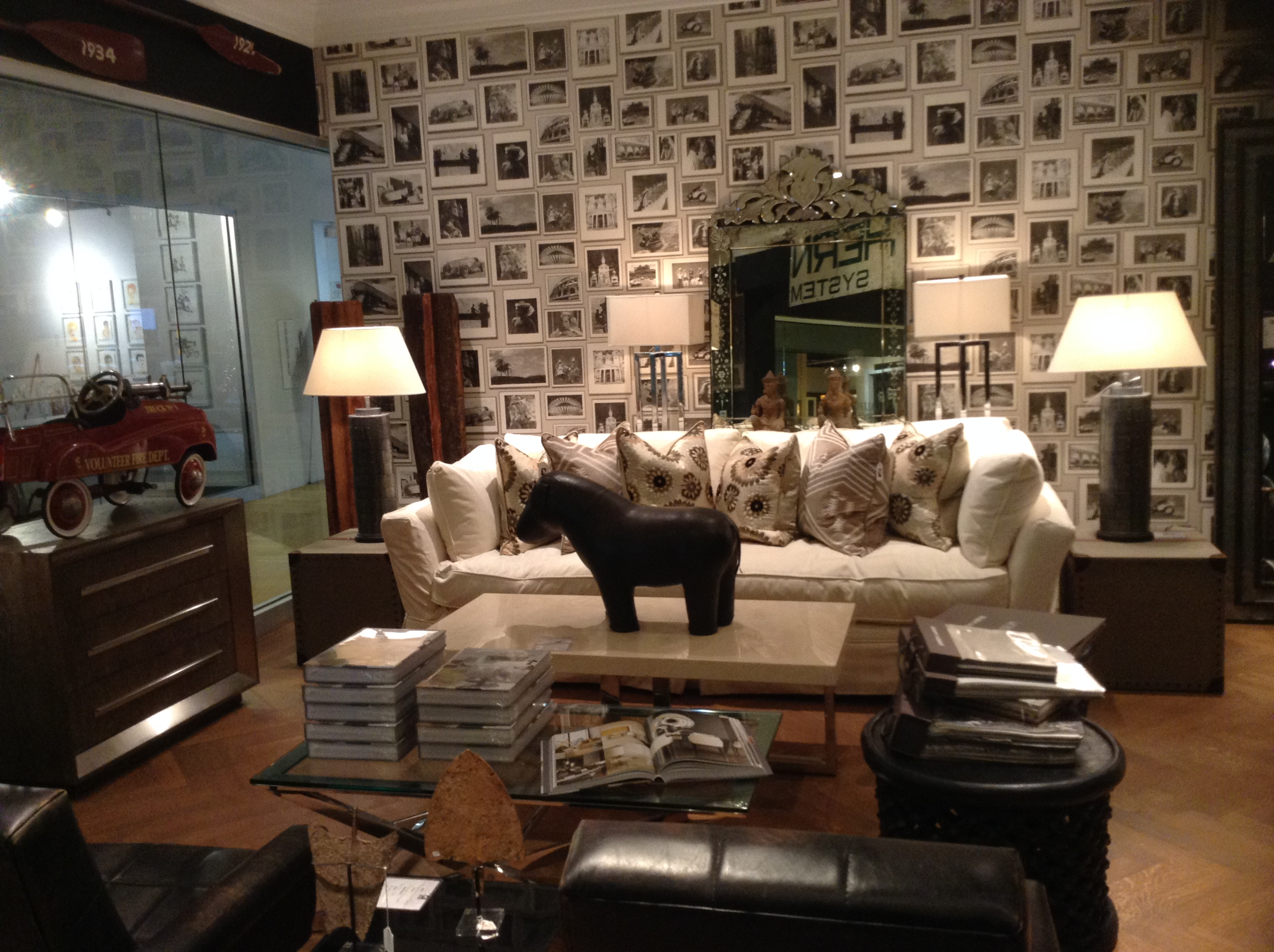 Andrew-Martins-Cadogan-Sofa-with-Celeste-cushions-infront-of-our-Studio-Venetian-Crown-wallpaper-wp5602901