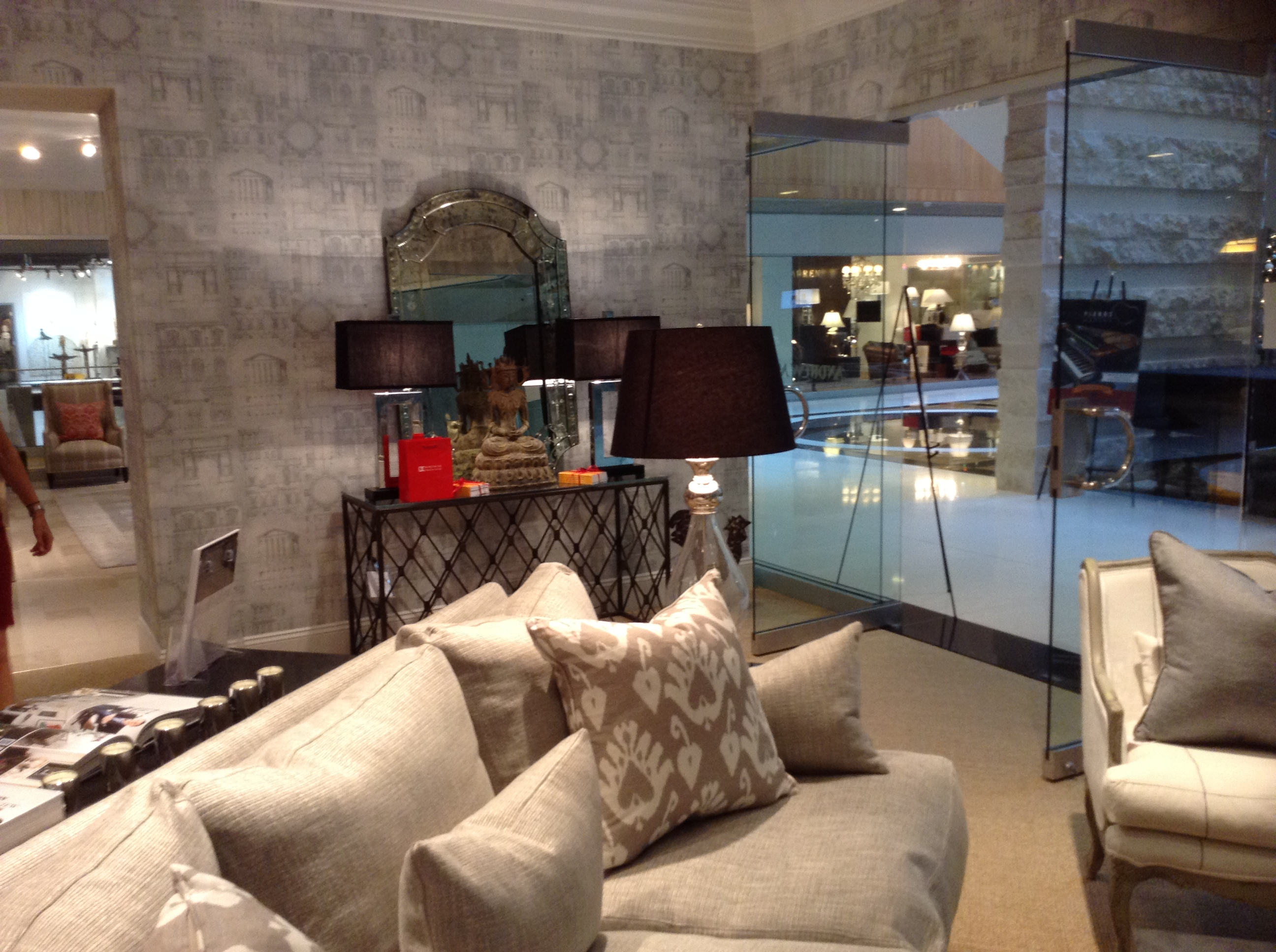 Andrew-Martins-Naples-Florida-Showroom-Showing-our-Augustus-Lucas-Console-Table-with-a-wallpaper-wp5602905