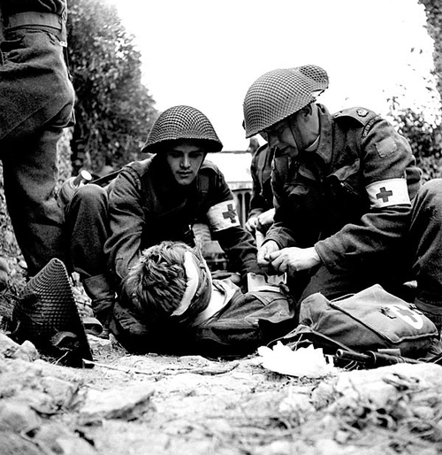 Canadian-medics-help-a-wounded-soldier-Juno-Beach-D-Day-June-th-wallpaper-wp3004118