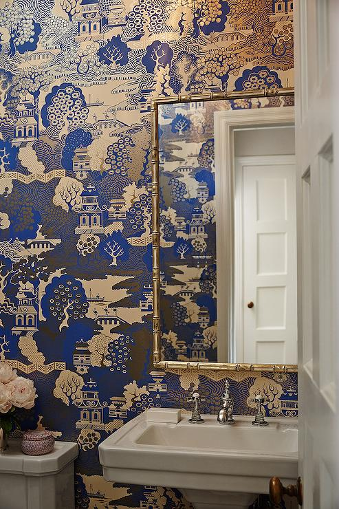 Chinoiserie-powder-room-features-walls-clad-in-Osborne-Little-Summer-Palace-lin-wallpaper-wp5603841