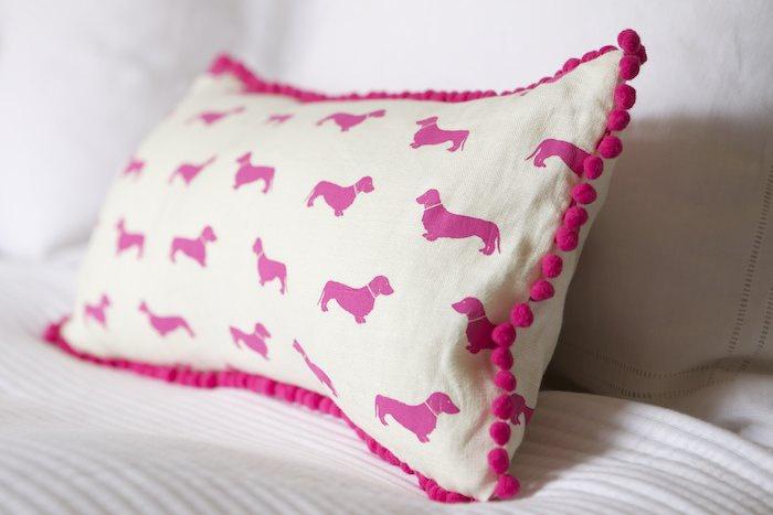 Emily-Bond-Dachshund-Pom-Pom-cushion-in-pink-wallpaper-wp425159-1