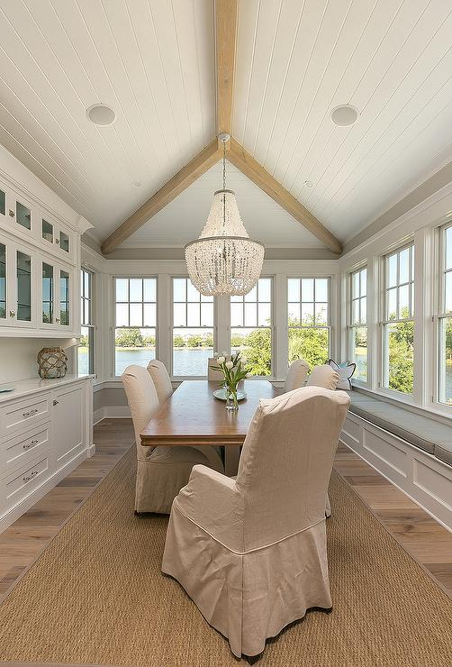 Exquisite-dining-room-boasts-a-rectangular-wood-dining-table-seating-natural-linen-skirted-dining-wallpaper-wp4605729