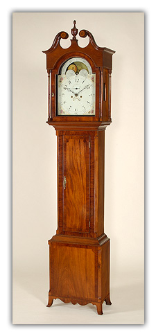 Federal-Inlaid-Mahogany-Tall-Case-Clock-having-a-broken-arch-top-centered-by-a-turned-finial-over-an-wallpaper-wp425381