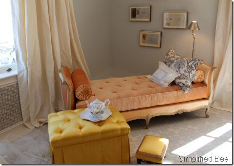 French-antique-daybed-upholstered-in-orange-silk-velvet-and-tufted-ottoman-in-Rose-Cummings-Canar-wallpaper-wp4606046