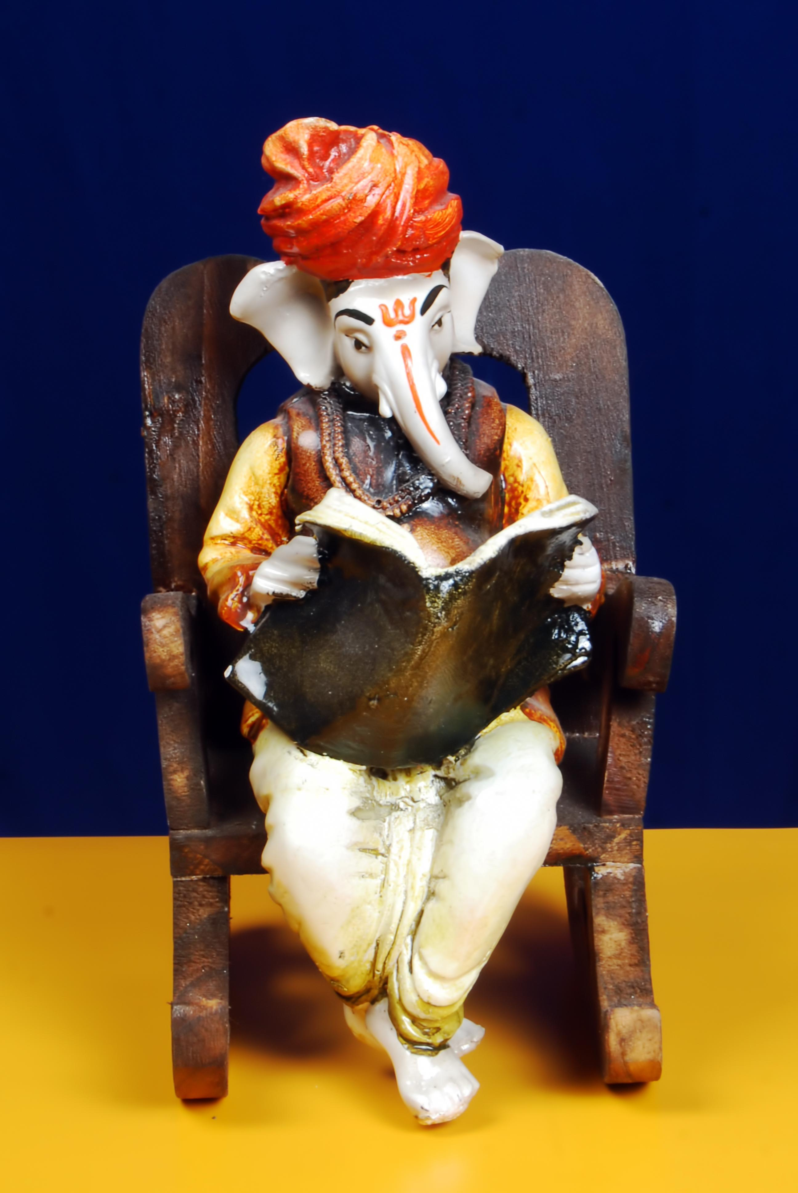 Ganesha-Ganesha-Reading-News-Paper-on-a-Wooden-Chair-Best-Price-wallpaper-wp4606145