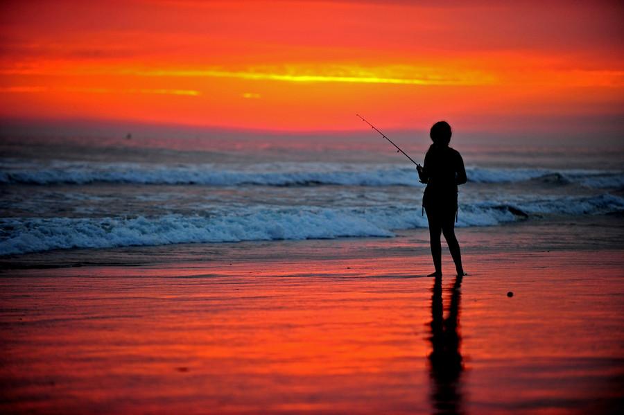 Girl-Surf-Fishing-at-Sunset-in-Oceanside-July-wallpaper-wp4407406