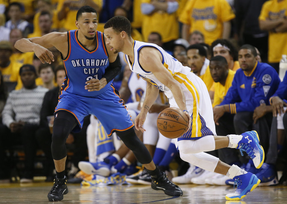 Golden-State-s-Stephen-Curry-goes-past-Oklahoma-City-s-Andre-Roberson-during-Game-of-t-wallpaper-wp3406298